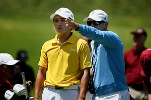 UCLA head coach Derek Freeman talks with Anton Arboleda at No. 3 during the final round of stroke play at the 2012 NCAA Championship.