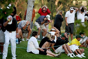 Spectators take cover as Texas player Julio Vegas' ball heads in their direction during the final round of stroke play at No. 9.