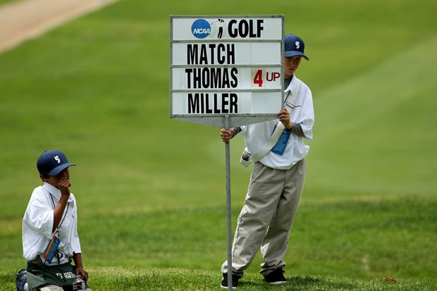 Sign bearers wait by the side of the ninth green during the first match of Alabama's Justin Thomas and Kent State's Kevin Miller during the first day of Match Play.