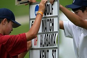 Brothers, Conner, left, and Steven Brown , right, work on changing the score of the Alabama/Kent State match during the first day of Match Play at the 2012 NCAA Championship at Riviera Country Club.