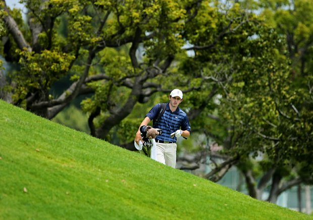 Patrick Cantlay of UCLA walks back toward the green after hitting a chip shot from the right side of the green at No. 9 during the first day of Match Play.