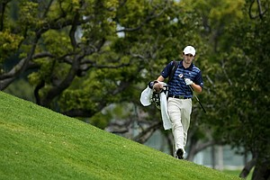 Patrick Cantlay of UCLA walks toward the green on the side hill at No. 9 during the first day of Match Play at the 2012 NCAA Championship.