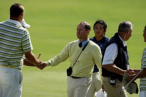 UCLA's Derek Freeman congratulates Oregon's Casey Martin after Eugene Wong defeated Anton Arboleda during the first day of Match Play at the 2012 NCAA Championship.