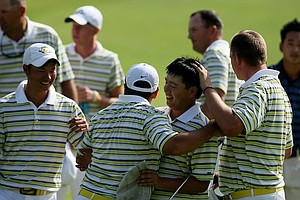 Oregon's Eugene Wong is surrounded by teammates after he defeated UCLA's Anton Arboleda during the first day of Match Play at the 2012 NCAA Championship. Oregon will face Texas in the semifinals.