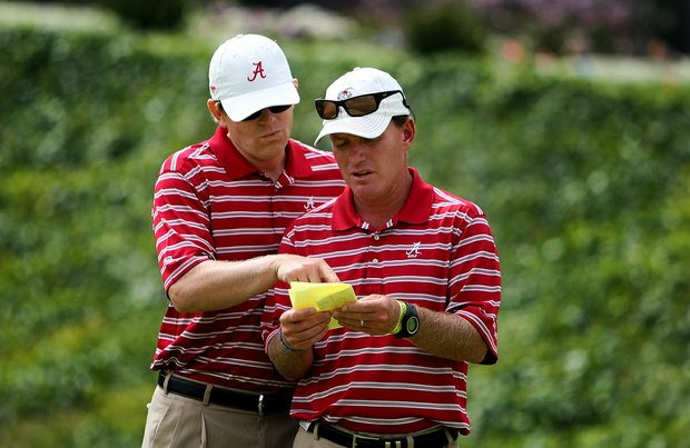 Alabama head coach Jay Seawell, right, and assistant Scott Limbaugh, left, talk about their pairings for the semifinals Match Play at the 2012 NCAA Championship.