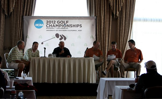 Oregon's head coach Casey Martin with assistant Brad Lanning, left, discuss pairings with Texas head coach John Fields, assistant Ryan Murphy and volunteer assistant, Jean-Paul Hebert  heading into the semifinals of Match Play at the 2012 NCAA Championship at Riviera Country Club in Pacific Palisades, Calif.
