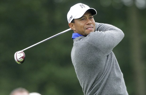 Tiger Woods watches his tee shot on the first hole during the second round of the Memorial golf tournament Friday, June 1, 2012, in Dublin, Ohio. Woods birdied the hole.
