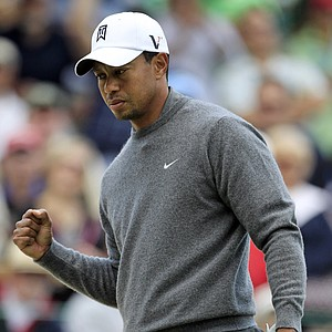 Tiger Woods pumps his fist after making a birdie putt on the first hole during the third round of the Memorial golf tournament at the Muirfield Village Golf Club in Dublin, Ohio, Saturday, June 2, 2012.