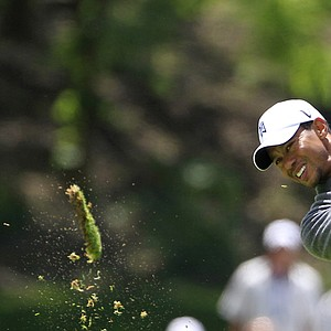 Tiger Woods hits from the second fairway during the third round of the Memorial golf tournament at the Muirfield Village Golf Club in Dublin, Ohio, Saturday, June 2, 2012.