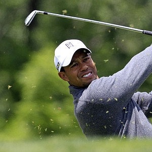 Tiger Woods tees off on the third hole during the third round of the Memorial golf tournament at the Muirfield Village Golf Club in Dublin, Ohio, Saturday, June 2, 2012.