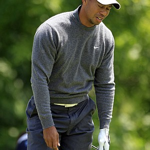 Tiger Woods reacts after teeing off on the fourth hole during the third round of the Memorial golf tournament at the Muirfield Village Golf Club in Dublin, Ohio, Saturday, June 2, 2012.