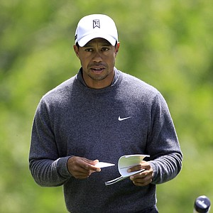 Tiger Woods walks up to the fourth tee box during the third round of the Memorial golf tournament at the Muirfield Village Golf Club in Dublin, Ohio, Saturday, June 2, 2012.