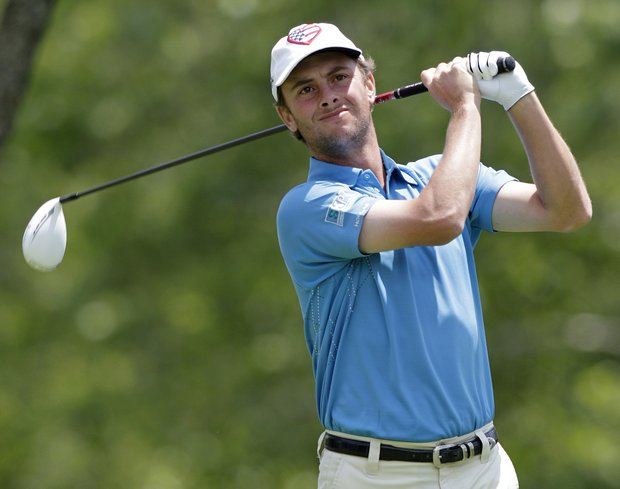 Spencer Levin watches his tee shot on the fifth hole during the third round of the Memorial golf tournament Saturday, June 2, 2012, in Dublin, Ohio.