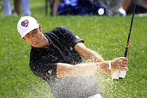 Dustin Johnson hits out of a sand trap on the first hole during the third round of the Memorial golf tournament at the Muirfield Village Golf Club in Dublin, Ohio, Saturday, June 2, 2012.