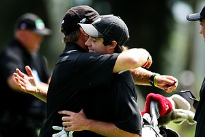 Alabama's Hunter Hamrick is hugged head coach Jay Seawell after clinching his match during semifinals of Match Play at the 2012 NCAA Championship. Alabama will face Texas in the finals.