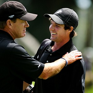 Alabama's head coach Jay Seawell congratulates Hunter Hamrick after he clinched his match during semifinals of Match Play at the 2012 NCAA Championship. Alabama will face Texas in the finals.