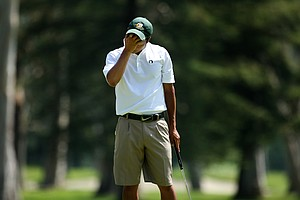 Oregon's Jonathan Woo reacts to losing his match at No. 17 to Cody Gribble of Texas during semifinals of Match Play at the 2012 NCAA Championship.