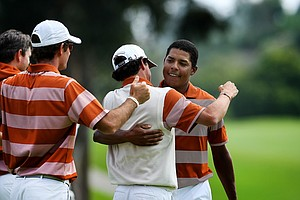 Julio Vegas of Texas is mobbed by his teammates after he won his match clinching their win over Oregon during semifinals of Match Play at the 2012 NCAA Championship.