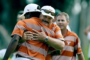 John Fields, head coach of Texas, hugs Julio Vegas after he clinched his match over Oregon during semifinals of Match Play at the 2012 NCAA Championship. Texas will face Alabama in the finals.