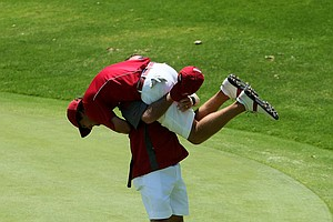 Alabama head coach Jay Seawell lifts his player, Bobby Wyatt, after he chipped in to win his match during the finals of match play at the 2012 NCAA Championship.