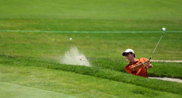 Dylan Frittelli of Texas hits out of a bunker during the finals of match play at the 2012 NCAA Championship. He placed fourth at Second Qualifying Stage to advance to Final Stage of European Tour Qualifying School.