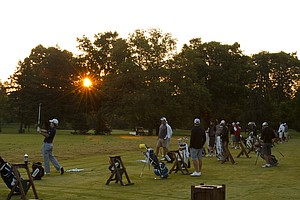 Players hit balls on the range early in the morning during the 2012 U.S. Open Sectional Qualifying at Scioto Country Club in Columbus, Ohio on Monday, June 4, 2012.