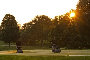 Members of the grounds crew mow the 18th green prior to the start of the 2012 U.S. Open Sectional Qualifying at Scioto Country Club in Columbus, Ohio on Monday, June 4, 2012.