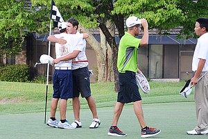 Brooks Koepka (second from left) hugs his younger brother, Chase, after Brooks birdied the par-5 18th hole in a sudden-death playoff against Andy Zhang, far right, for the final qualifying spot at the 2012 U.S. Open sectional at Black Diamond Ranch in Lecanto, Fla.