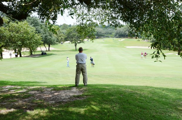Carl Brainerd Sr., 56, of Chicago, Ill. takes in the action at the par-5 5th hole, watching the Daniel Berger-Benjamin Silverman group during the second round of the 2012 U.S. Open sectional qualifier at Black Diamond Ranch in Lecanto, Fla.