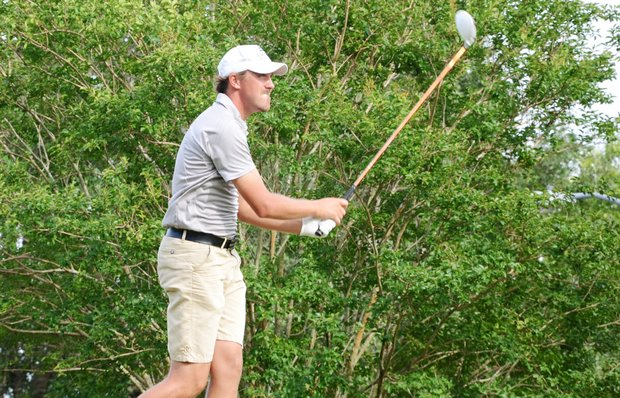 Sam Osborne tees off at the par-5 18th hole. He would go on to par the hole and finish at 3 under to take one of three automatic qualifying spots at the U.S. Open sectional at Black Diamond Ranch in Lecanto, Fla.