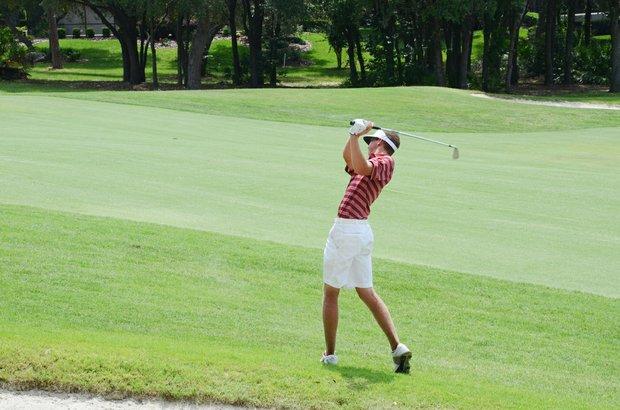 Florida State freshman Daniel Berger hits his second shot at the par-5 18th hole at Black Diamond Ranch in a 2012 U.S. Open sectional qualifier in Lecanto, Fla. on Monday. Berger held the 18-hole lead at 4 under.