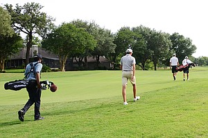 Sam Osborne, second from left, and his caddie, Craig Bellamy, left, walk up the 18th fairway, with Chase and Brooks Koepka leading the way. Both Koepka and Osborne would qualifying for the 2012 U.S. Open during a sectional qualifier at Black Diamond Ranch in Lecanto, Fla.