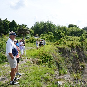 Fans watch Sam Saunders on the 17th green, a lengthy par-3 hole that is at the bottom of the quarry at Black Diamond Ranch in Lecanto, Fla. Saunders would fire a 77 in his second round of the day at the U.S. Open sectional qualifier.
