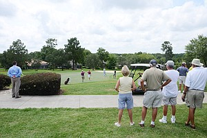Patrons watch as Florida State freshman Daniel Berger and Canada's Benjamin Silverman finish up their front-nine at the par-5 9th hole at Black Diamond Ranch in a 2012 U.S. Open sectional qualifier in Lecanto, Fla. on Monday. Berger held the 18-hole lead at 4 under.