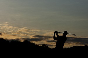 Brice Garnett warms up on the driving range before the start of the 2012 U.S. Open Sectional Qualifying at Springfield Country Club in Springfield, Ohio.
