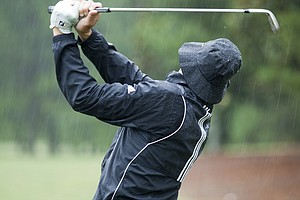 A golfer watches his shot during the 2012 U.S. Open Sectional Qualifying at The River Club in Suwanee, Ga.