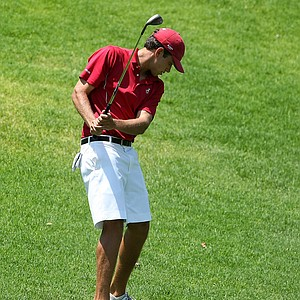 Alabama's Cory Whitsett stands stunned over his ball after whiffing his third shot at No. 18.