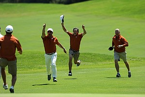 Cody Gribble of Texas runs down the fairway after Dylan Frittelli sunk a birdie putt at No. 18 to win the 2012 NCAA Championship.