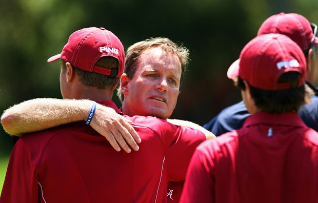 Alabama coach Jay Seawell consoles his players after the finals of match play at the 2012 NCAA Championship. Alabama lost to Texas, with Dylan Frittelli clinching the final point.