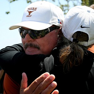 Texas coach John Fields gets conratulatory hugs after Texas won the 2012 NCAA Championship.