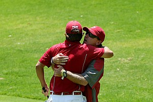 Alabama head coach Jay Seawell hugs Bobby Wyatt after he chipped in at No. 18 to win his match during the finals.