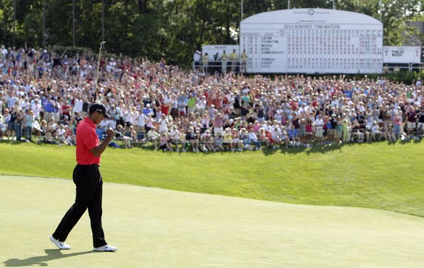 Tiger Woods pumps his fist after making a birdie putt on the 18th hole during the final round of the Memorial golf tournament.