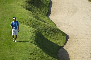 Arnond Vongvanij walks along a bunker on the 15th fairway during the 2012 U.S. Open Sectional Qualifying at Black Diamond Ranch (Quarry Course) in Lecanto, Fla.