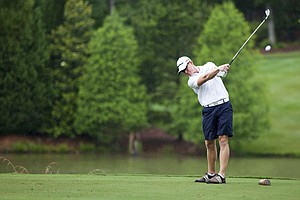 Mitchell Krywulycz plays his tee shot on the third hole during the 2012 U.S. Open Sectional Qualifying at The River Club in Suwanee, Ga.