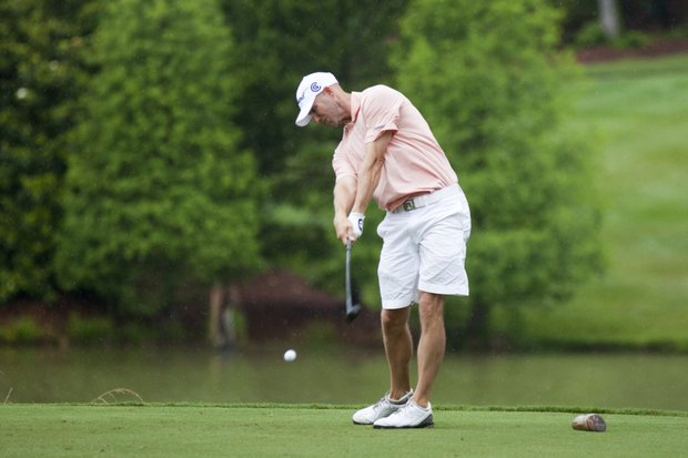 Elliott Gealy plays his tee shot on the third hole during the 2012 U.S. Open Sectional Qualifying at The River Club in Suwanee, Ga.