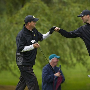 Casey Martin of Eugene, Oregon, celebrates with his caddie, Josh Unruh, after chipping in for birdie at the 26th hole, during the 2012 U.S. Open Sectional Qualifying at Emerald Valley Golf Club in Creswell, Ore. on Monday, June 4, 2012.
