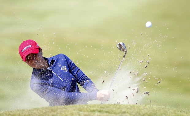 Lisa McCloskey hits out of a bunker at Nairn Golf Club.