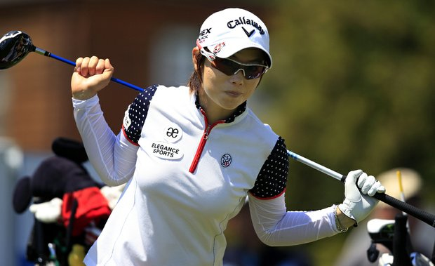 Eun-Hee Ji, of South Korea, stretches before hitting her tee shot on the first hole during the second round of the LPGA ShopRite Classic golf competition at Stockton Seaview Hotel and Golf Club in Galloway Township, N.J., Saturday, June 2, 2012.