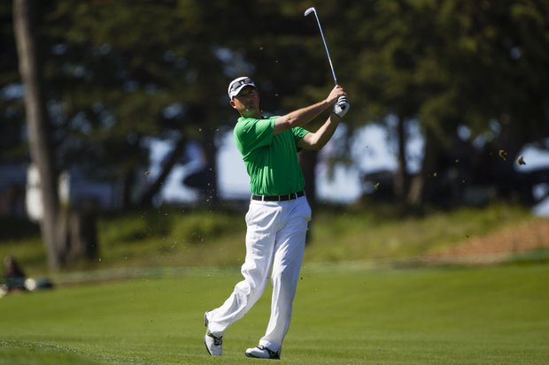 Casey Martin plays from the fairway on the first hole during a practice round at the 2012 U.S. Open at The Olympic Club in San Francisco, Calif. on Monday, June 11, 2012.