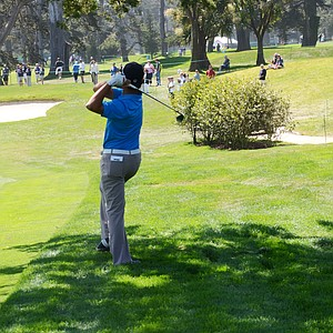 Andy Zhang, 14, hits an off-balance shot from the long rough at the par-4 6th hole at Olympic Club in San Francisco. He'd hit the green with the shot.